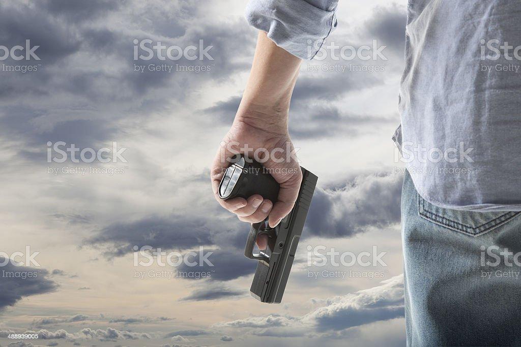 Man Holding Gun stock photo