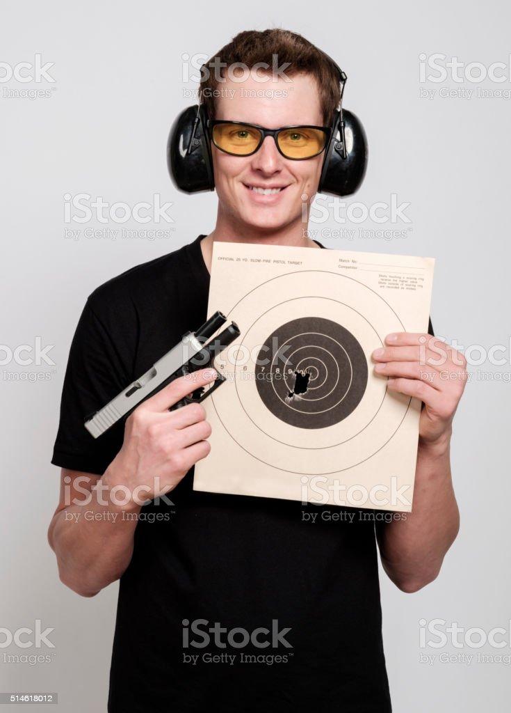 Man Holding Handgun and Target stock photo