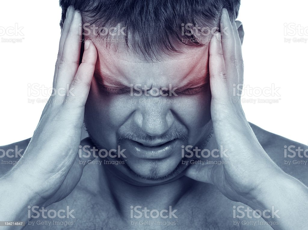 Man holding hands to head due to terrible migraine stock photo