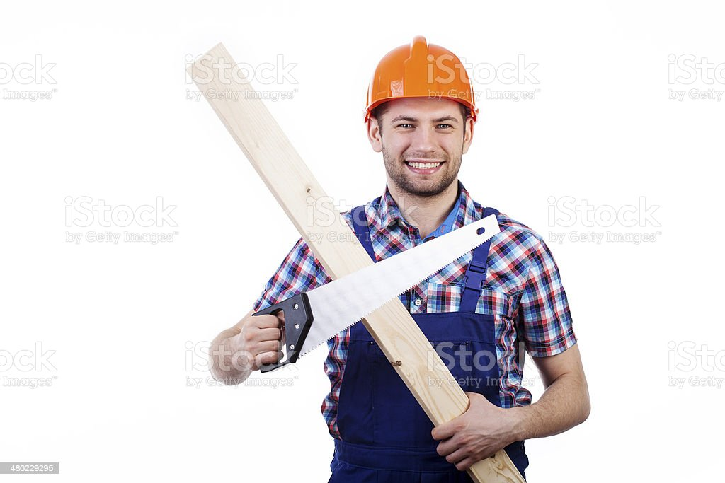 Man holding handsaw and plank royalty-free stock photo