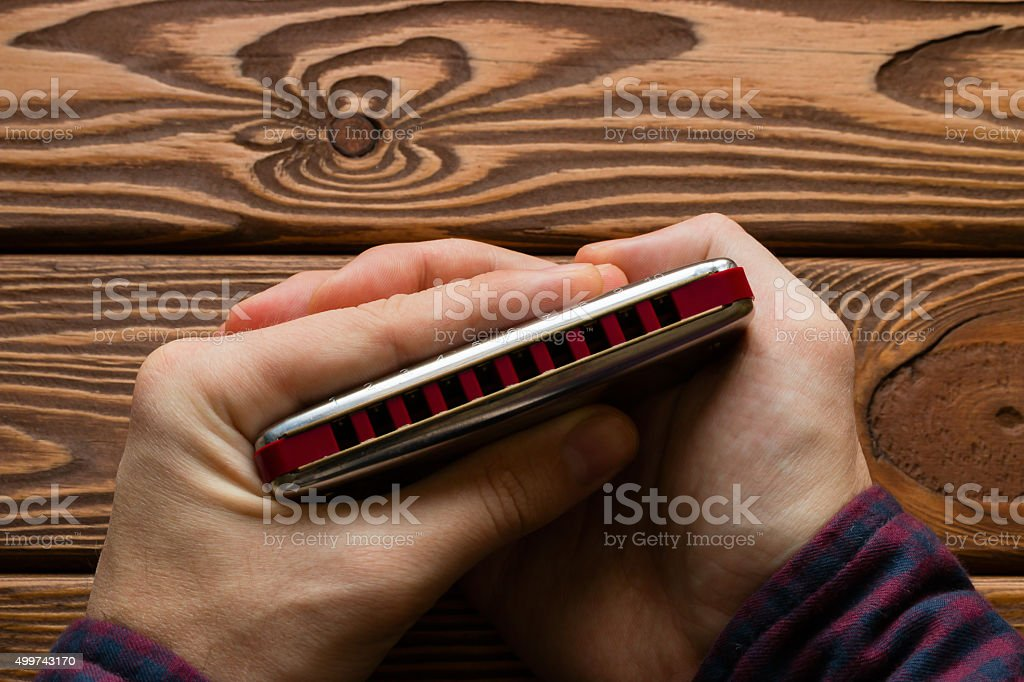 man holding harmonica a special grip stock photo