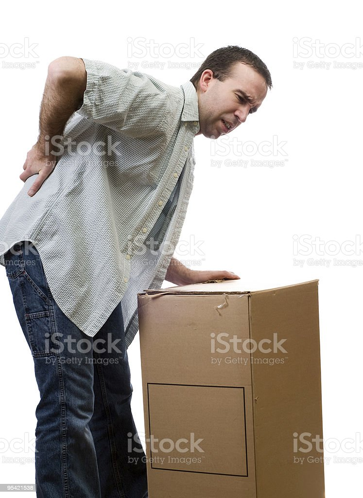 A man holding his back leaning on a box royalty-free stock photo