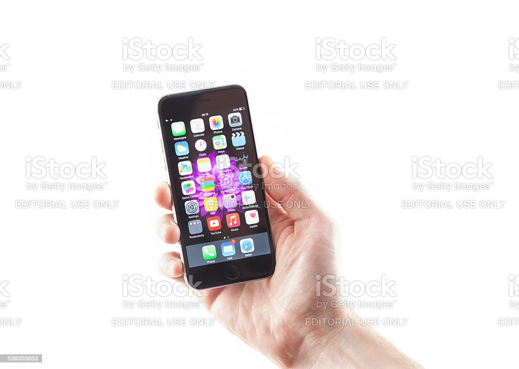 Man holding his brand new iPhone 6 stock photo