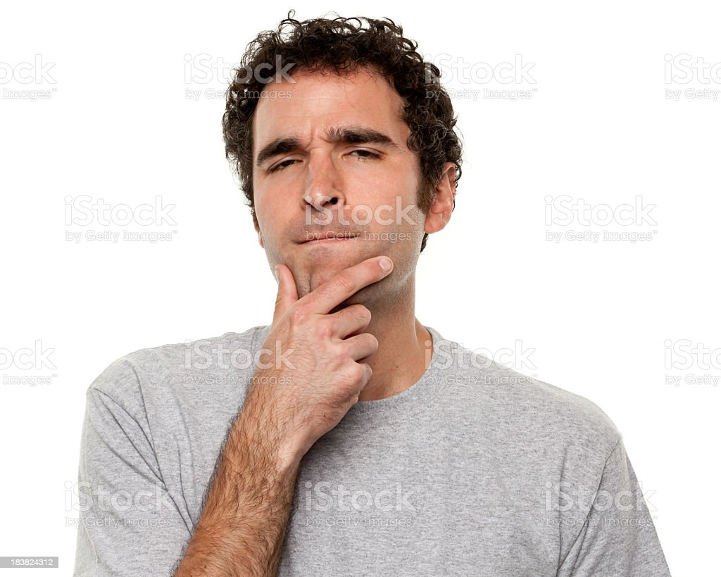 Man holding his chin in a deep-in-thought expression royalty-free stock photo