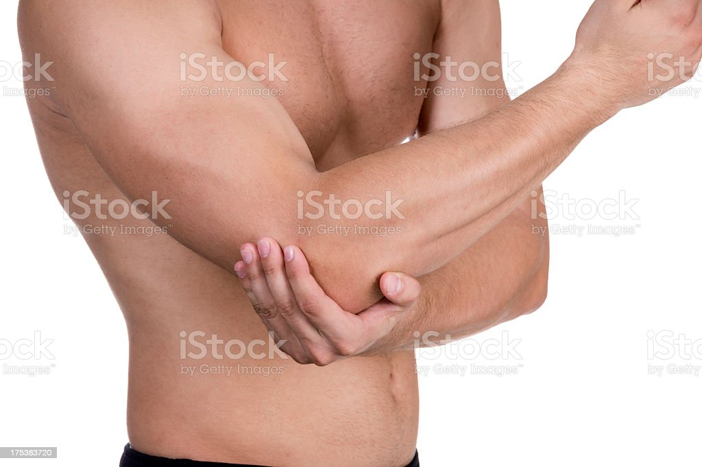 Man holding his elbow because it hurts stock photo
