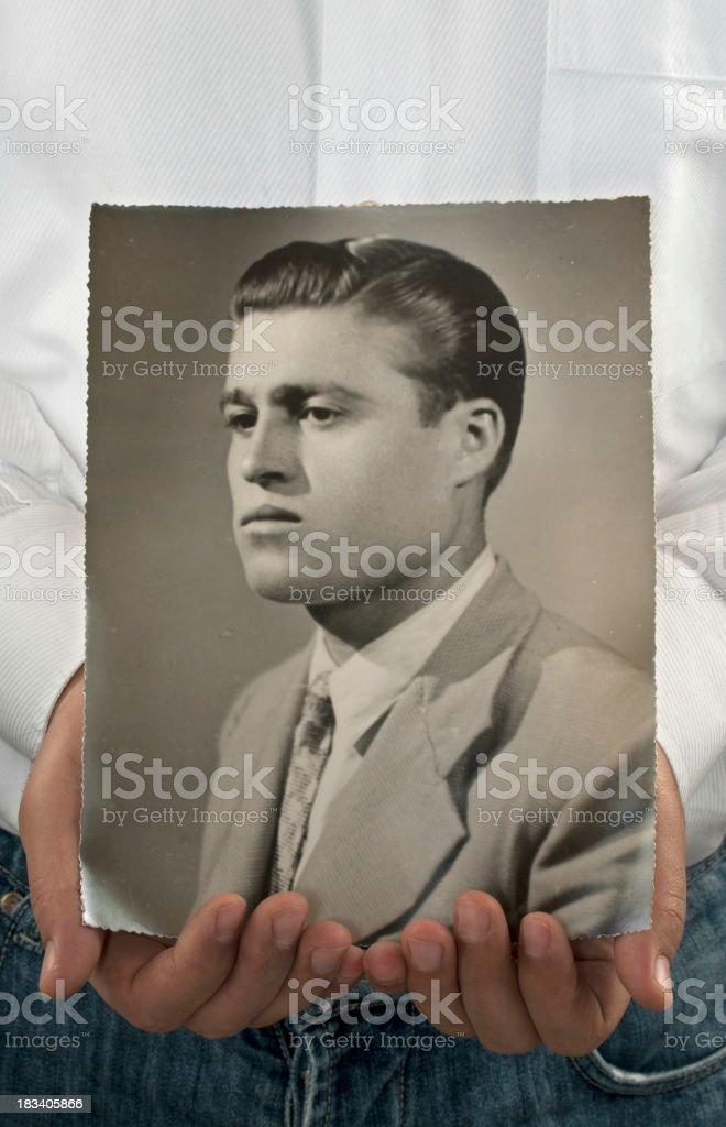 Man Holding His Father's Old Photo stock photo