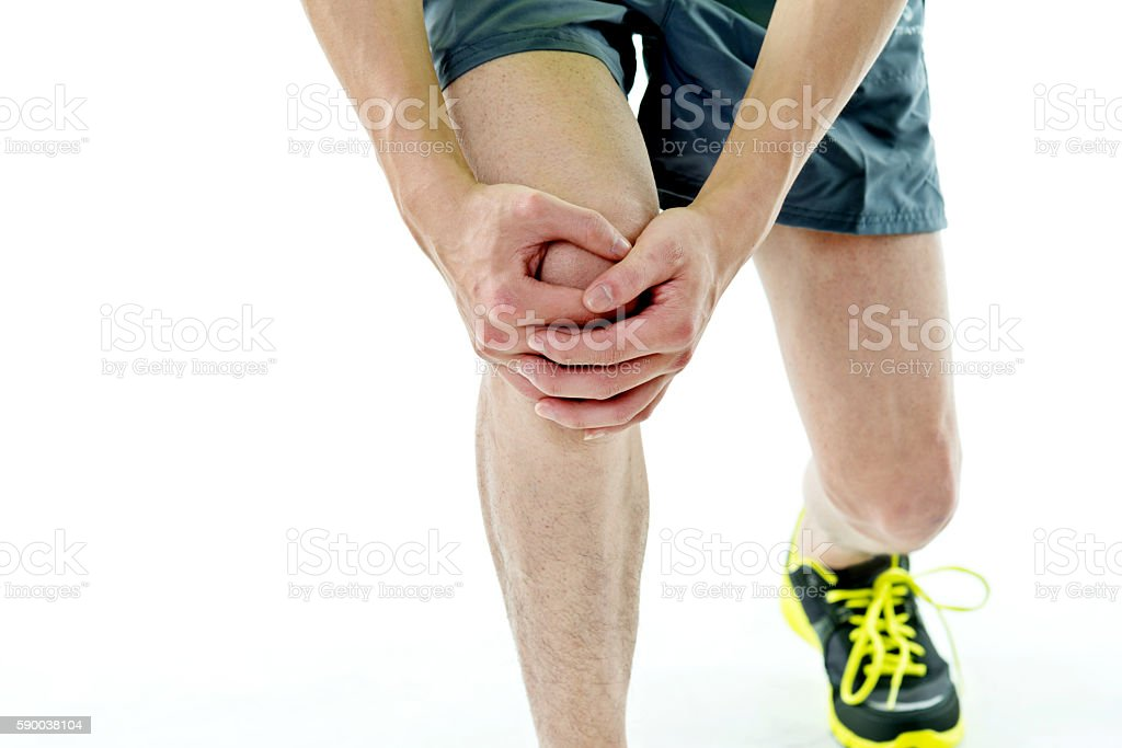 Man holding his painful knee stock photo