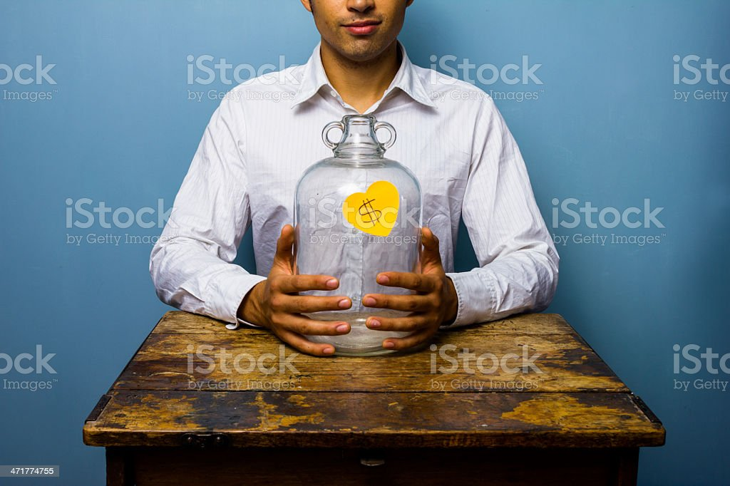 Man holding his piggy bank royalty-free stock photo