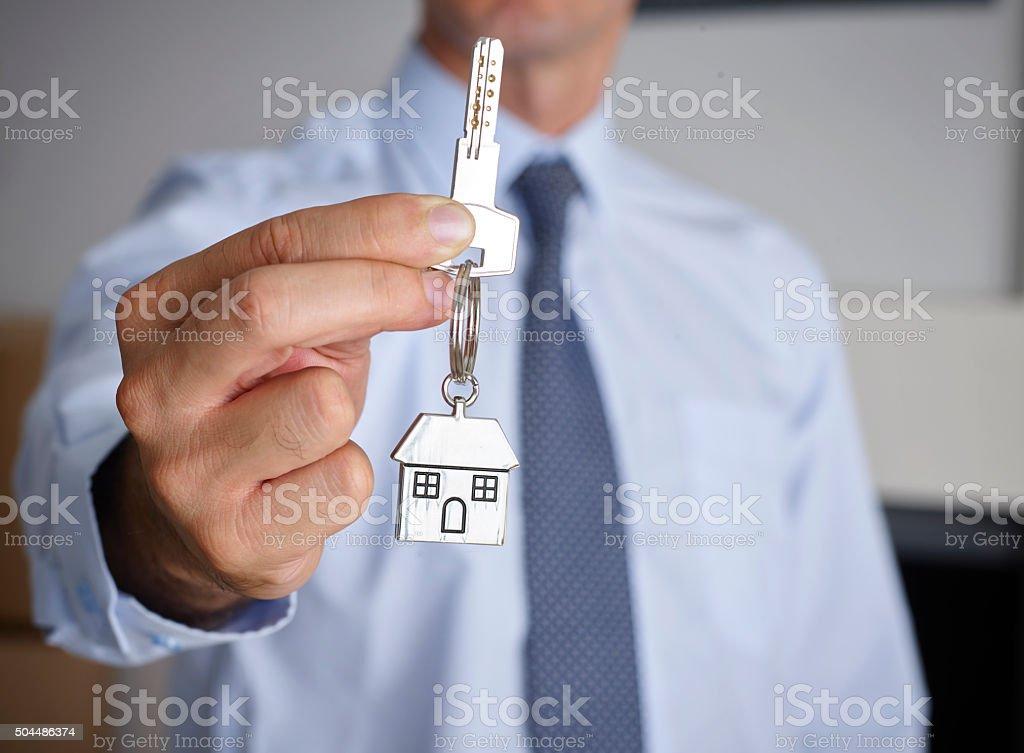 Man holding house key stock photo
