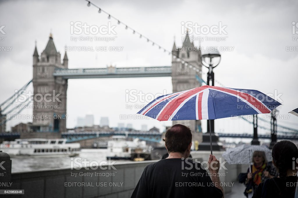 Man holding huge British flag umbrella stock photo