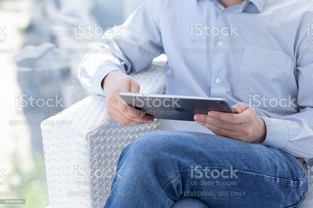 Man holding in the hand a iPad Pro Space Gray stock photo