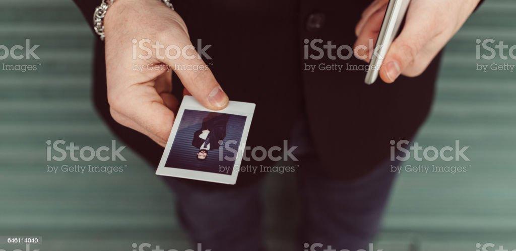 Man holding instant photo stock photo