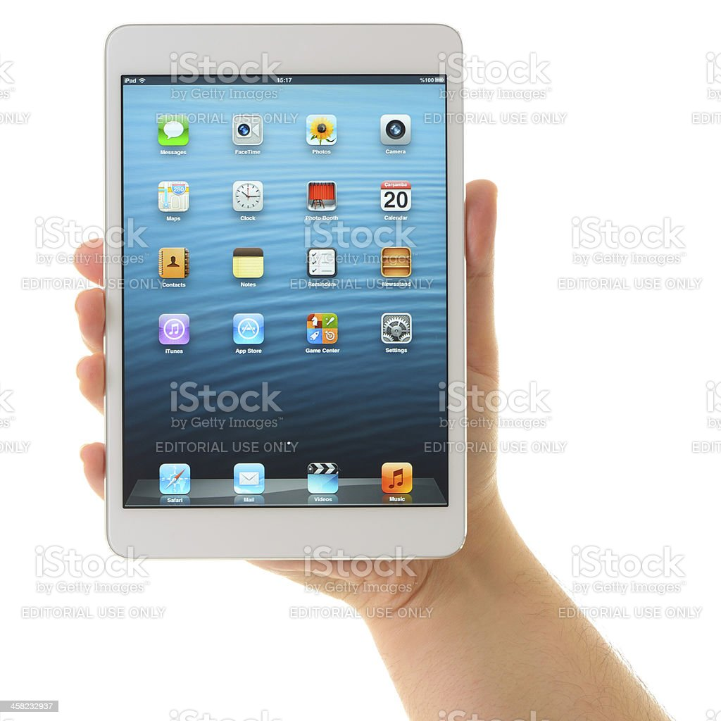 Man holding iPad Mini White royalty-free stock photo