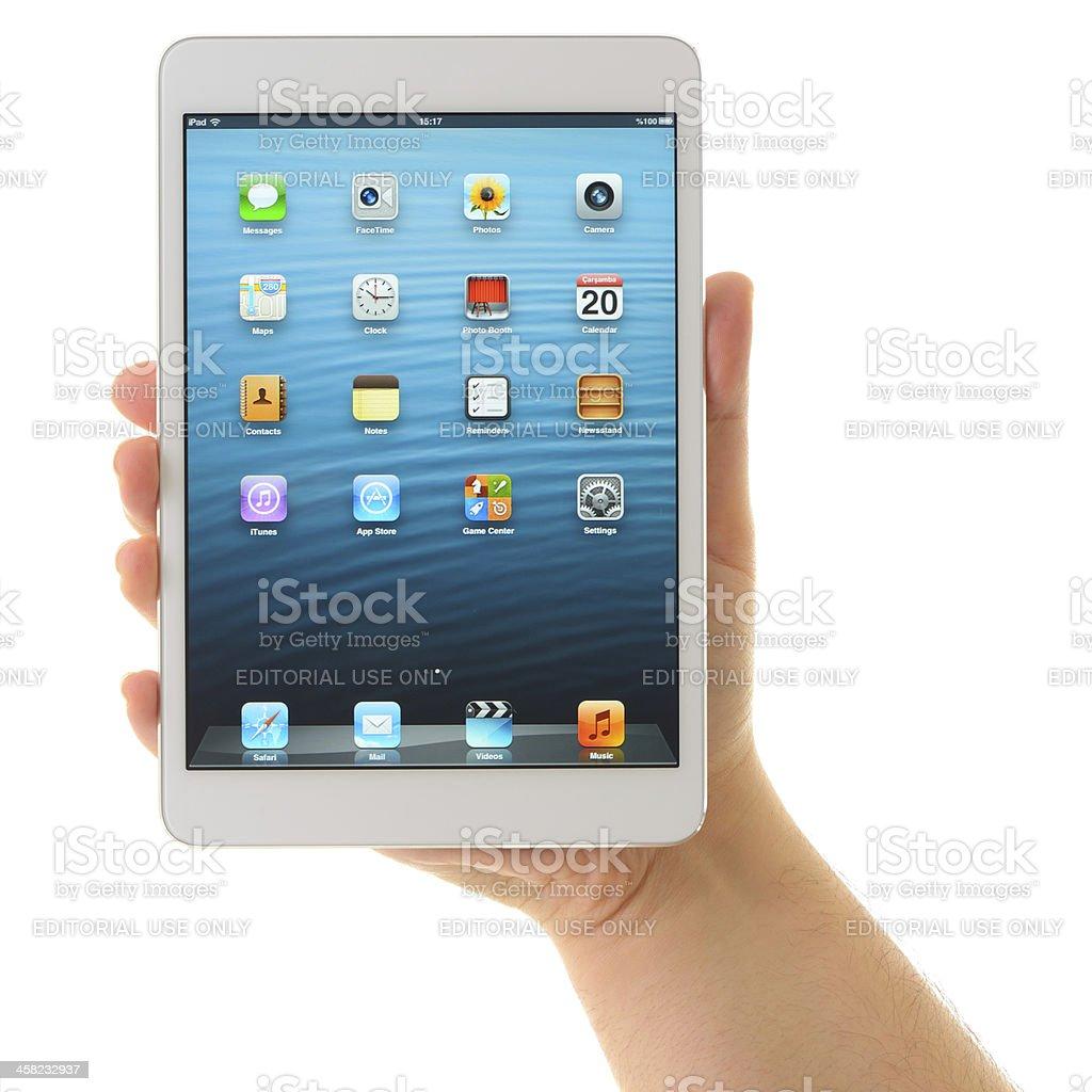 Man holding iPad Mini White stock photo