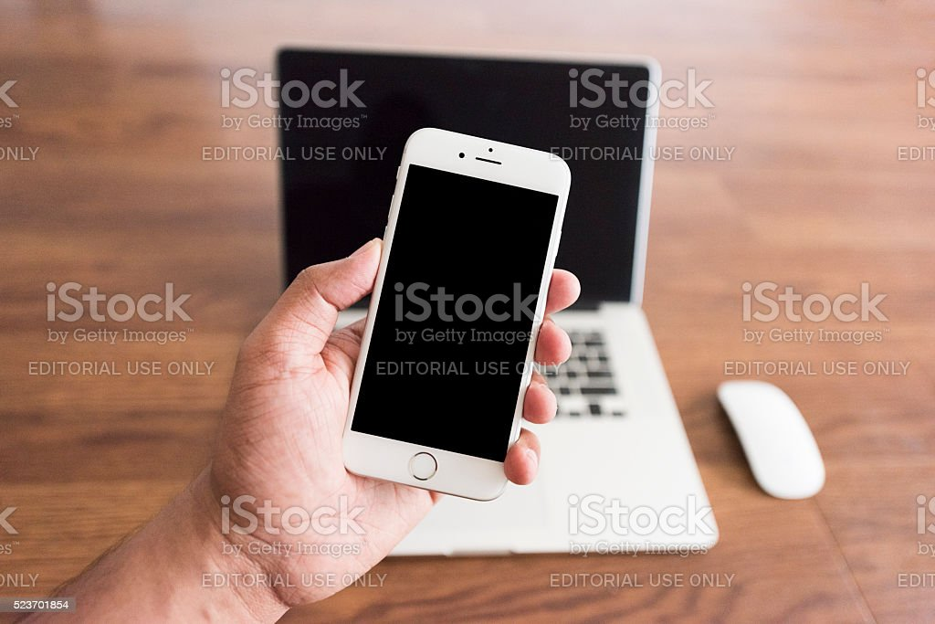 Man holding iPhone 6s stock photo
