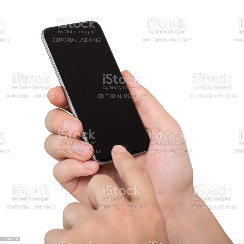 Man holding Isolated new iPhone 6 Space Gray stock photo