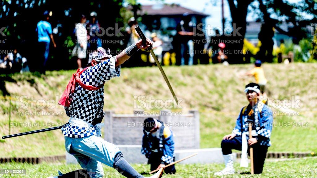 Man holding katana sword and doing kendo performance stock photo