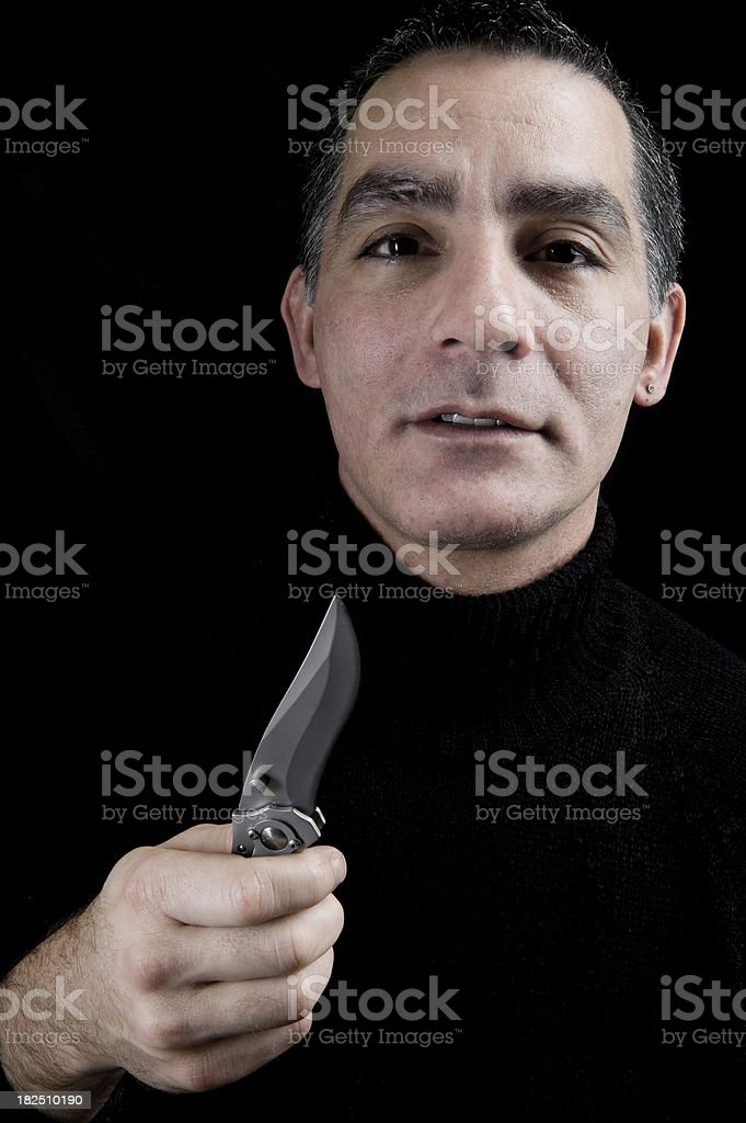 Man Holding Knife Blade stock photo