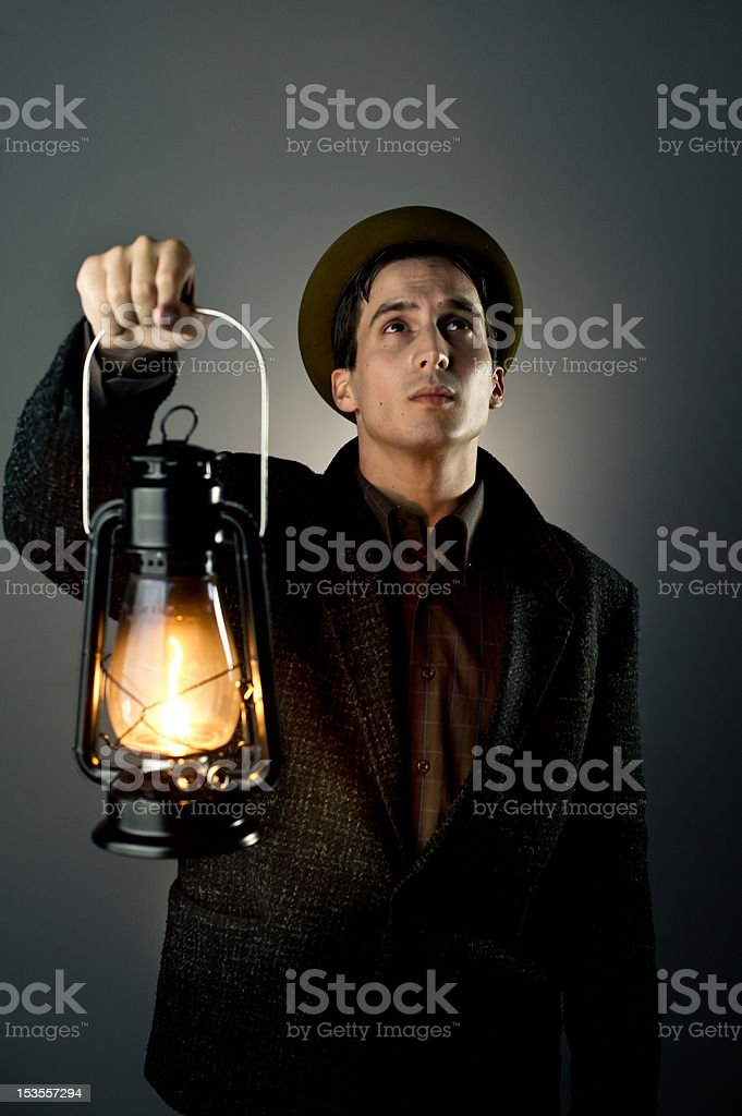 Man holding lantern stock photo