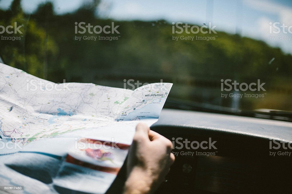 Man holding map of Australia stock photo