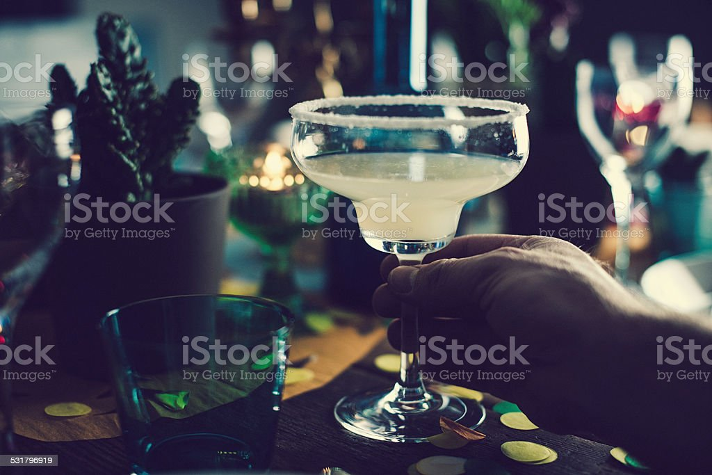 Man holding margarita stock photo