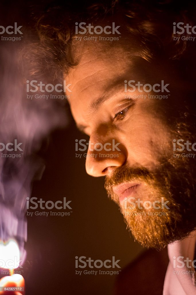 Man holding matchstick on fire royalty-free stock photo