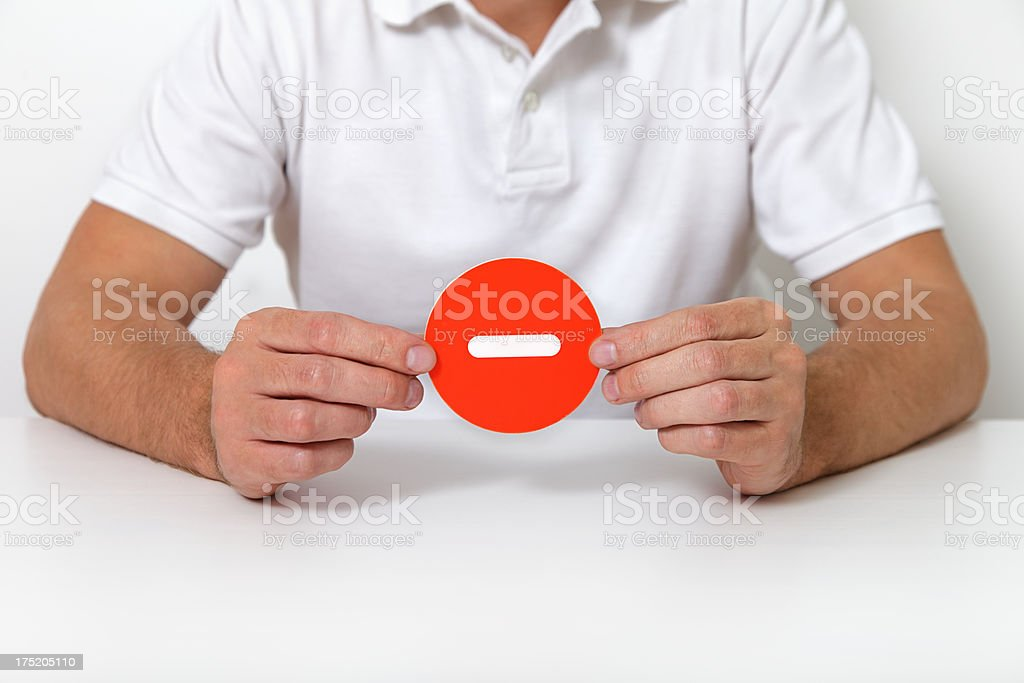 man holding minus sign royalty-free stock photo