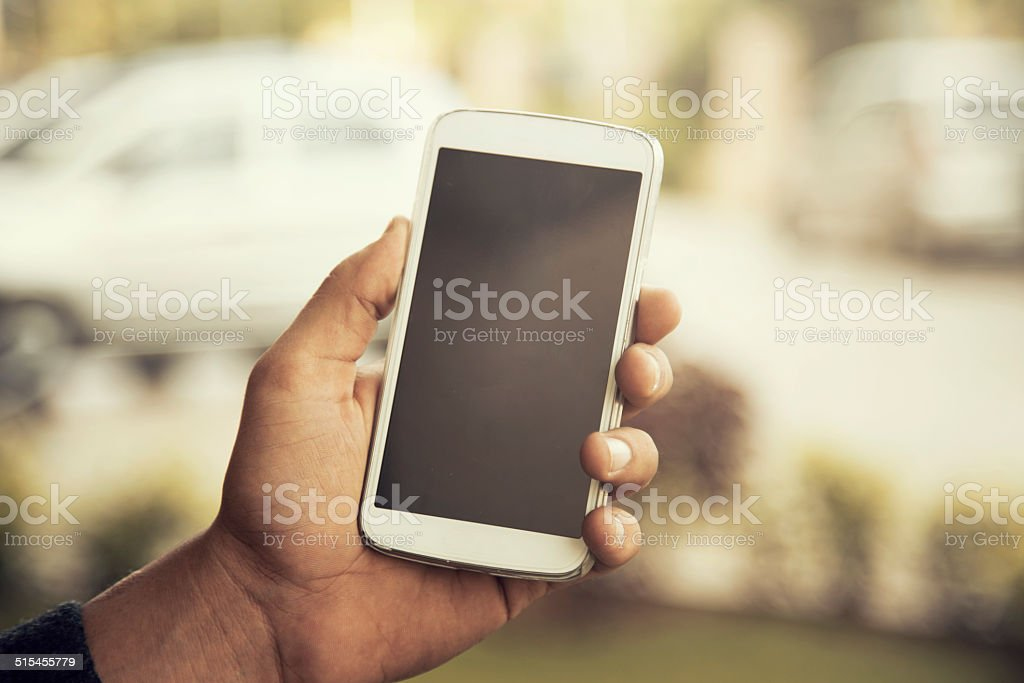 Man Holding Mobile Phone stock photo