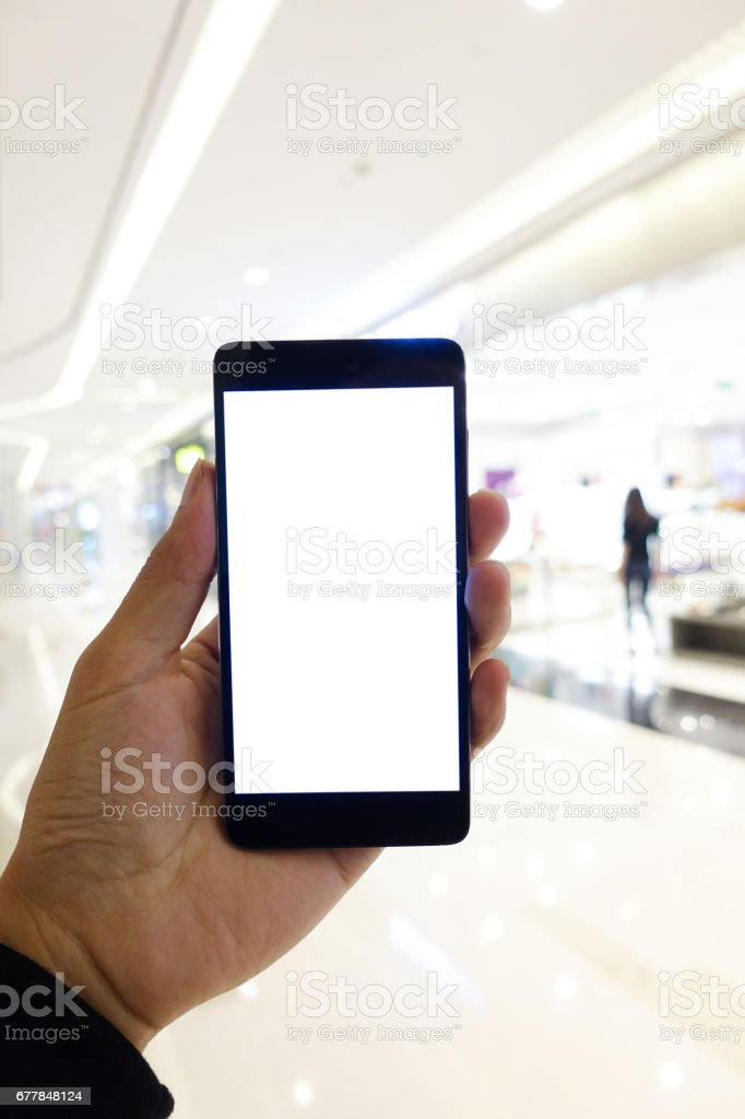 Man holding mobile phone with white screen stock photo