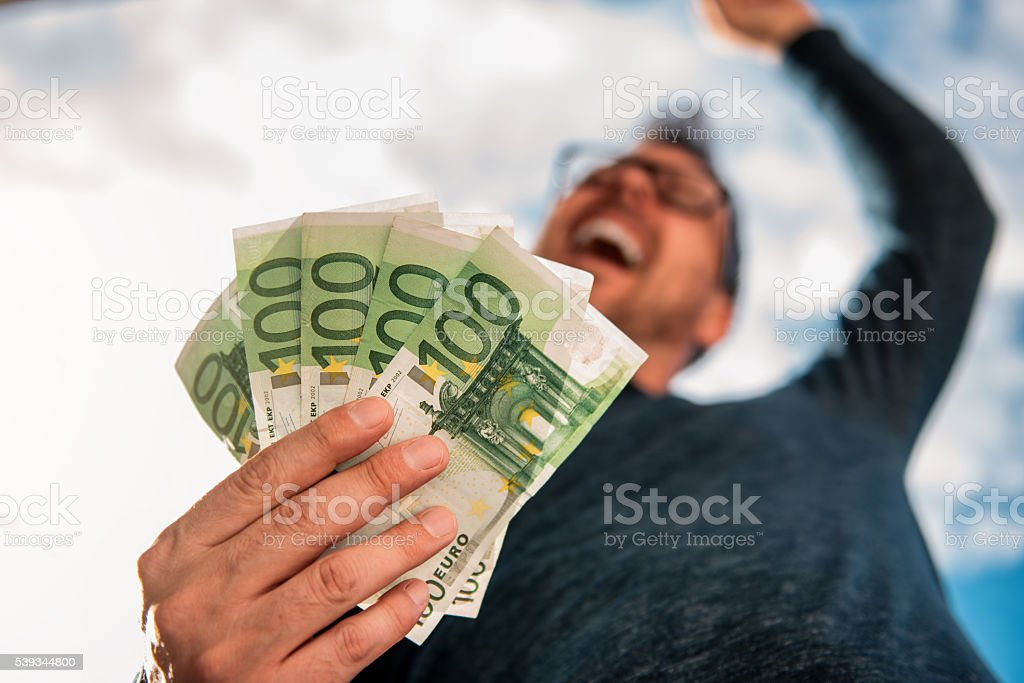 Man Holding Money stock photo
