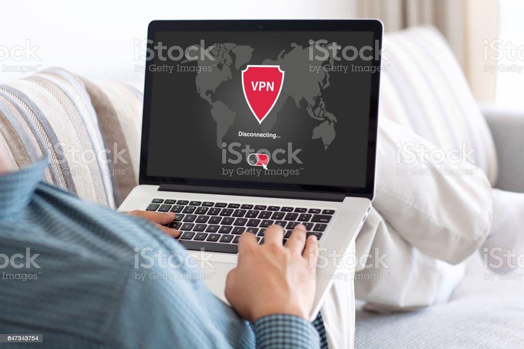 man holding notebook app vpn creation Internet protocols protection network stock photo