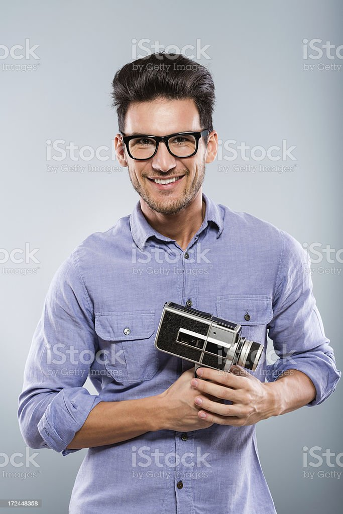 Man holding old fashioned video camera royalty-free stock photo