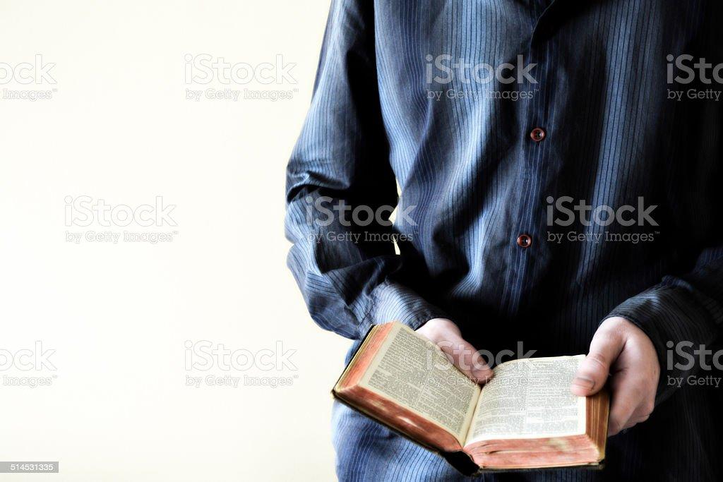 Man Holding Open Bible stock photo