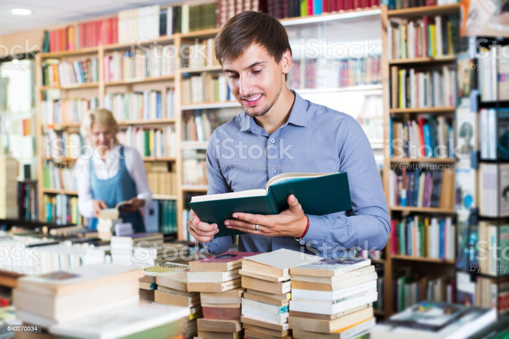 Man holding open book stock photo