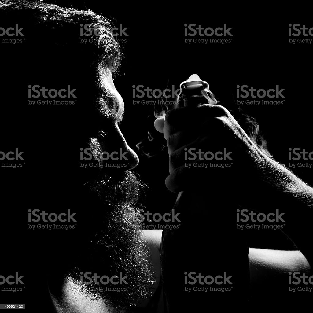 Man holding open wine bottle stock photo