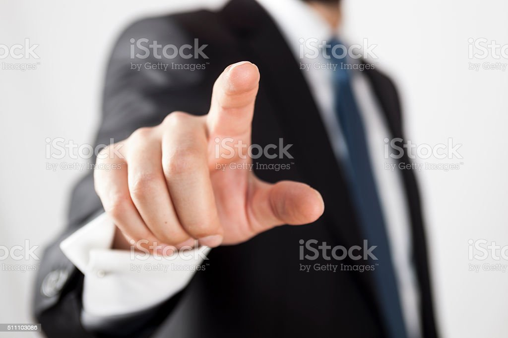Man holding out his hand to touch clear screen stock photo