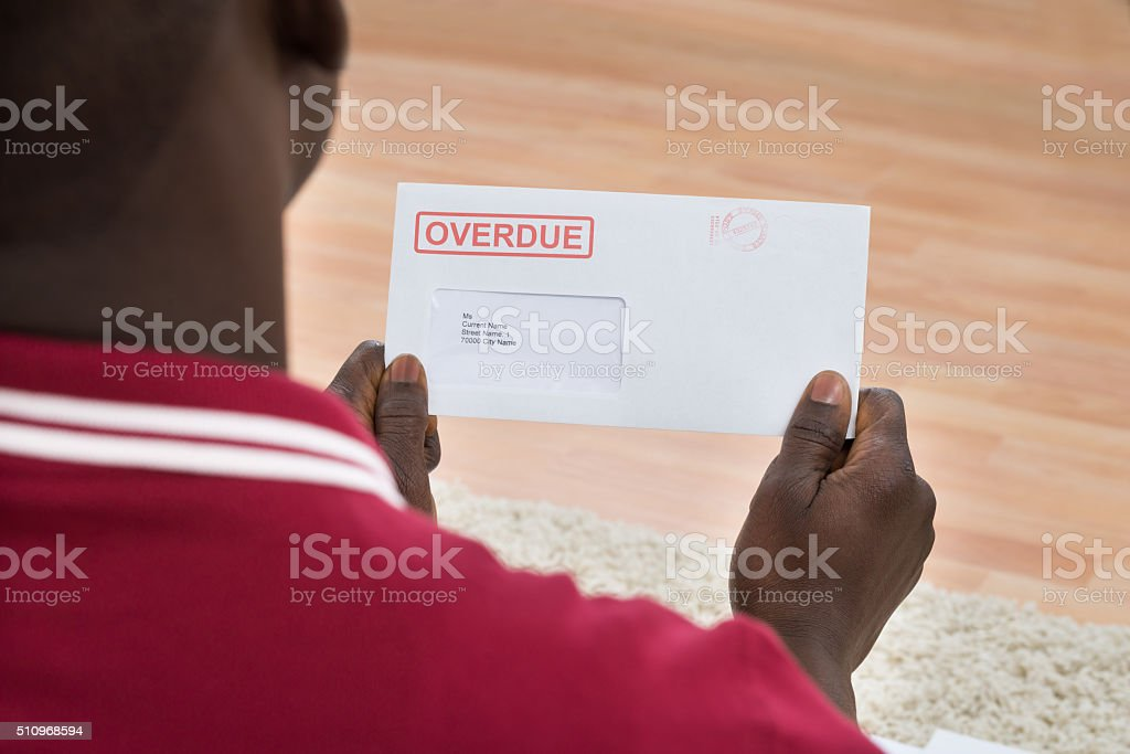 Man Holding Overdue Notice stock photo