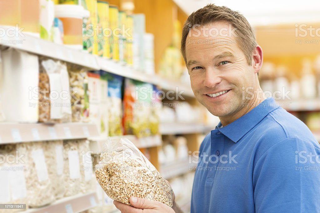 Man Holding Packet Of Cereals royalty-free stock photo