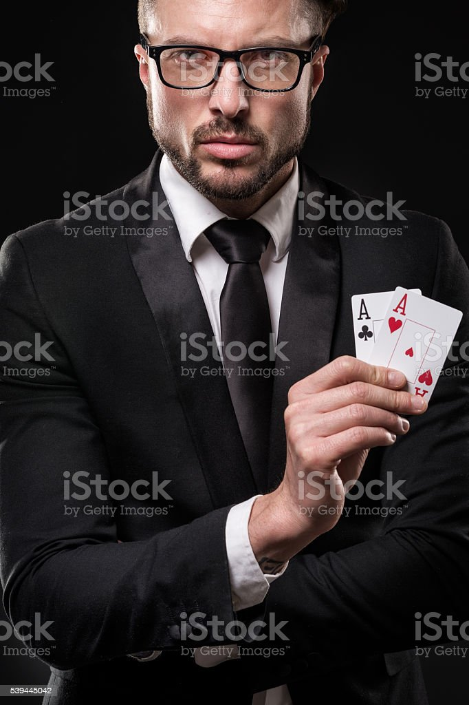 Man holding pair of aces stock photo