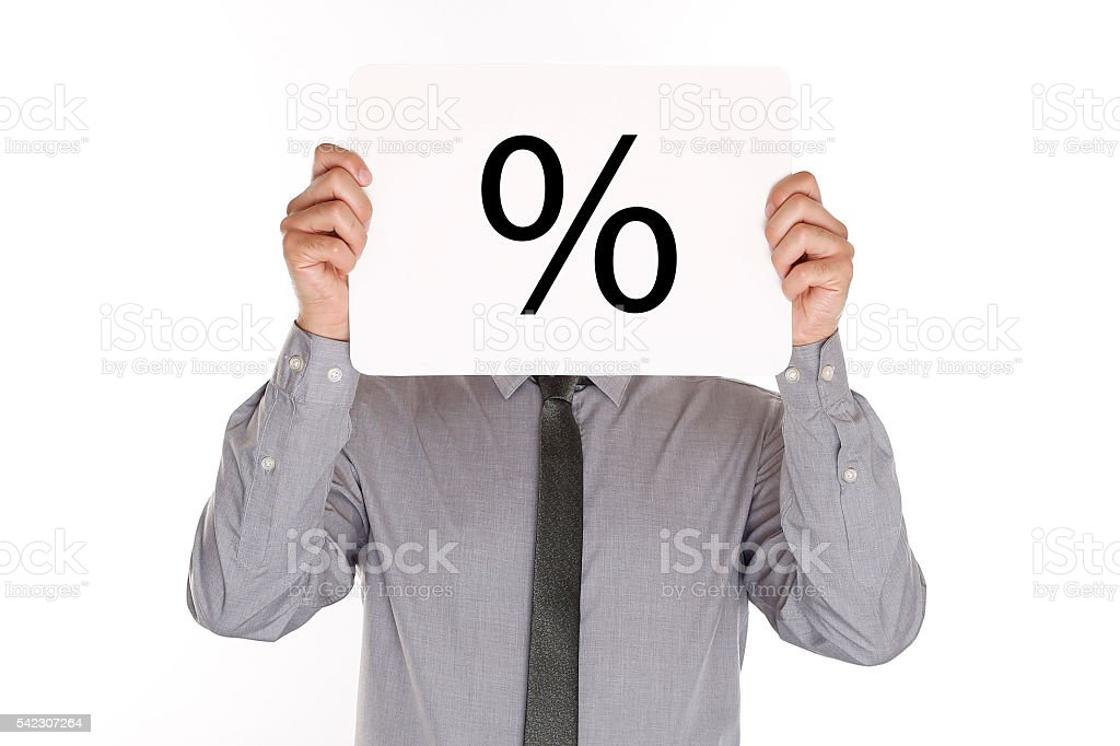 Man Holding Paper With Percent Sign stock photo