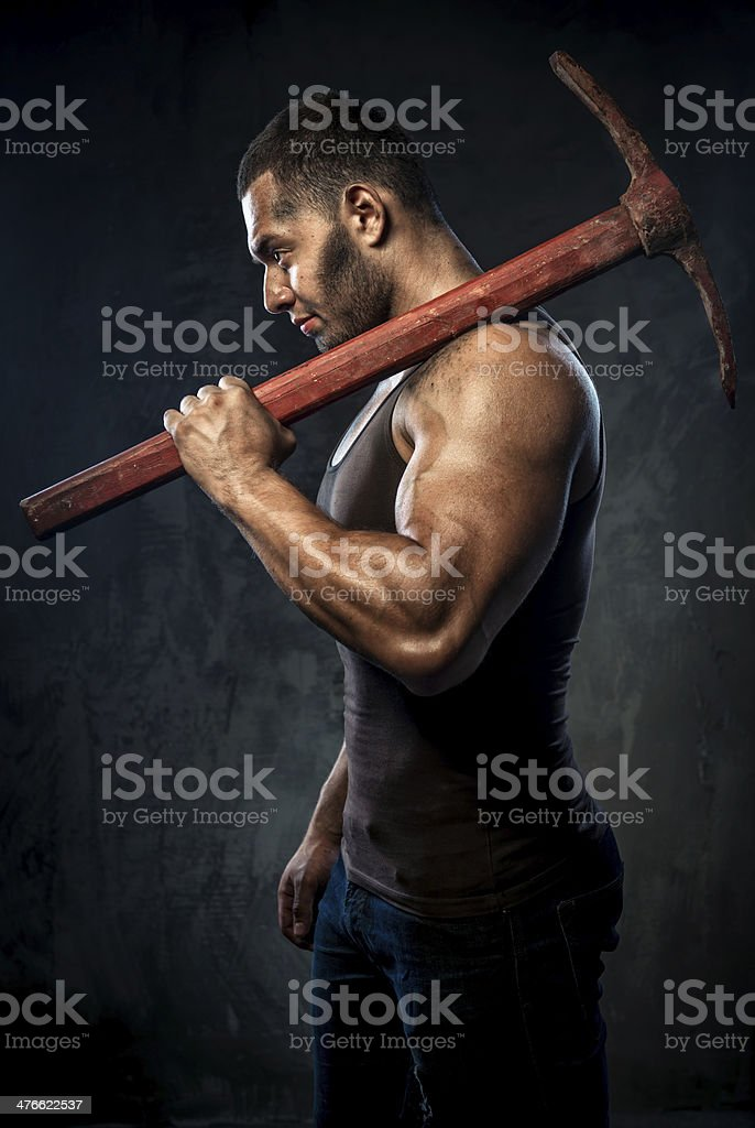 Man holding pickaxe royalty-free stock photo