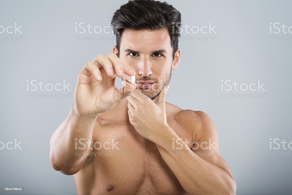 Man holding pill stock photo