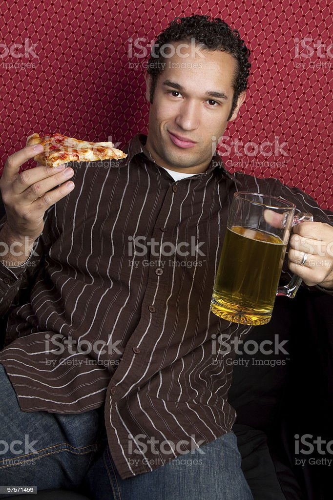 Man Holding Pizza and Beer royalty-free stock photo