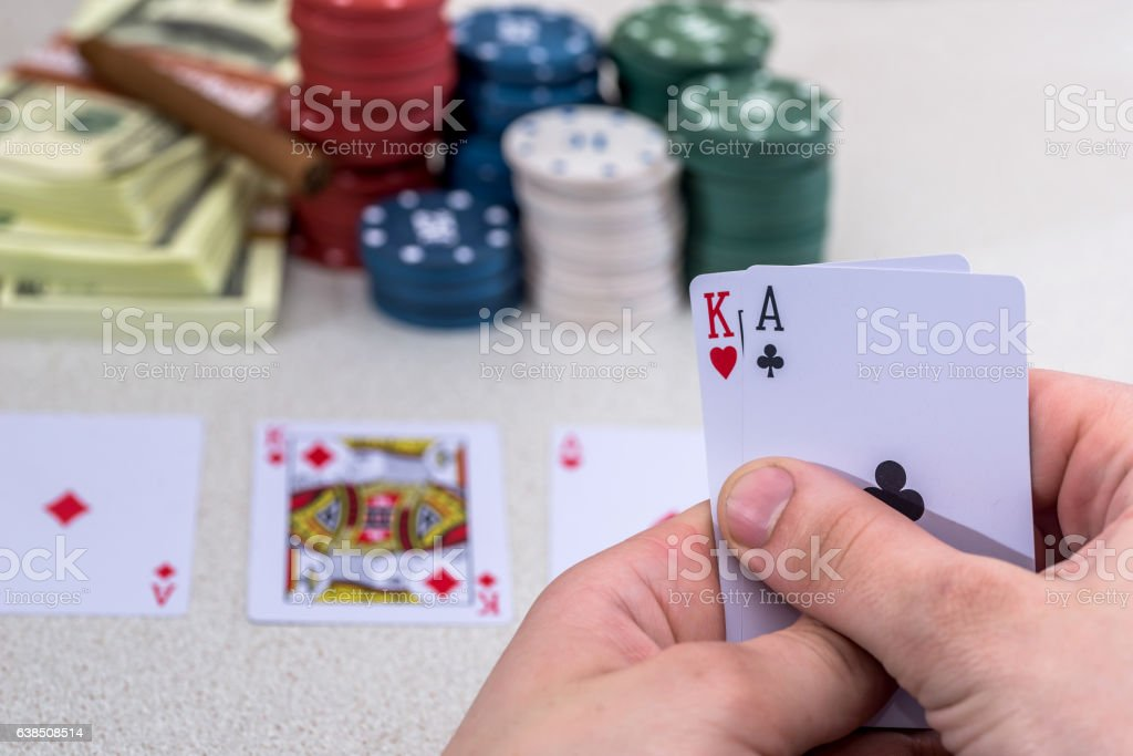 man holding play card stock photo