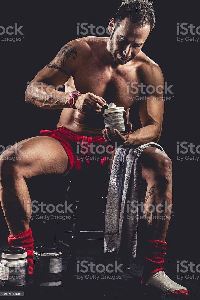 Man holding protein bottle stock photo