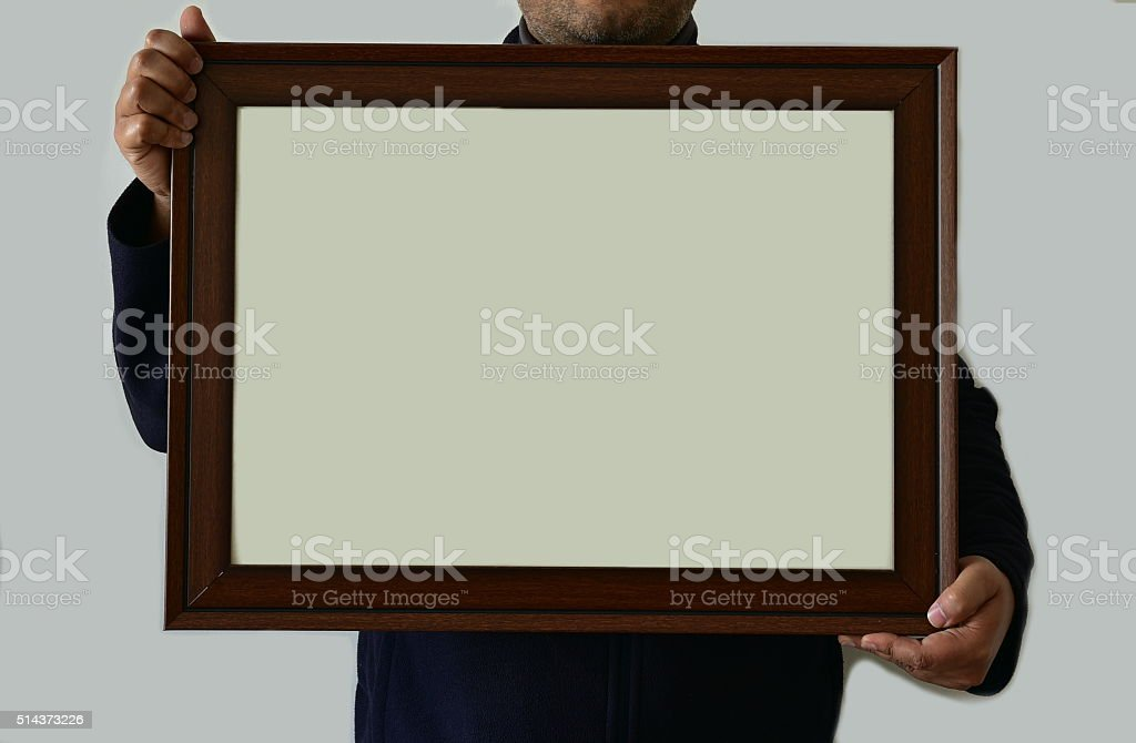 Man holding real picture frame stock photo