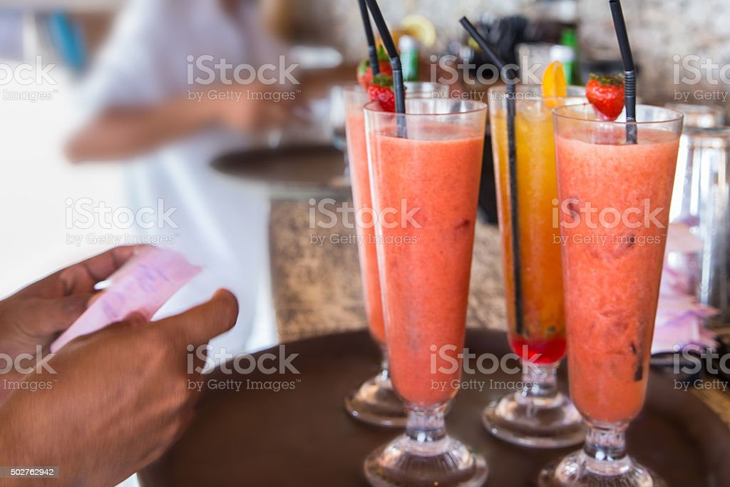 Man holding receipt of healthy juices stock photo