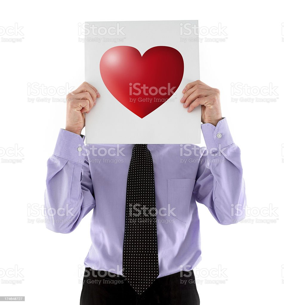 Man Holding Red Heart Sign stock photo