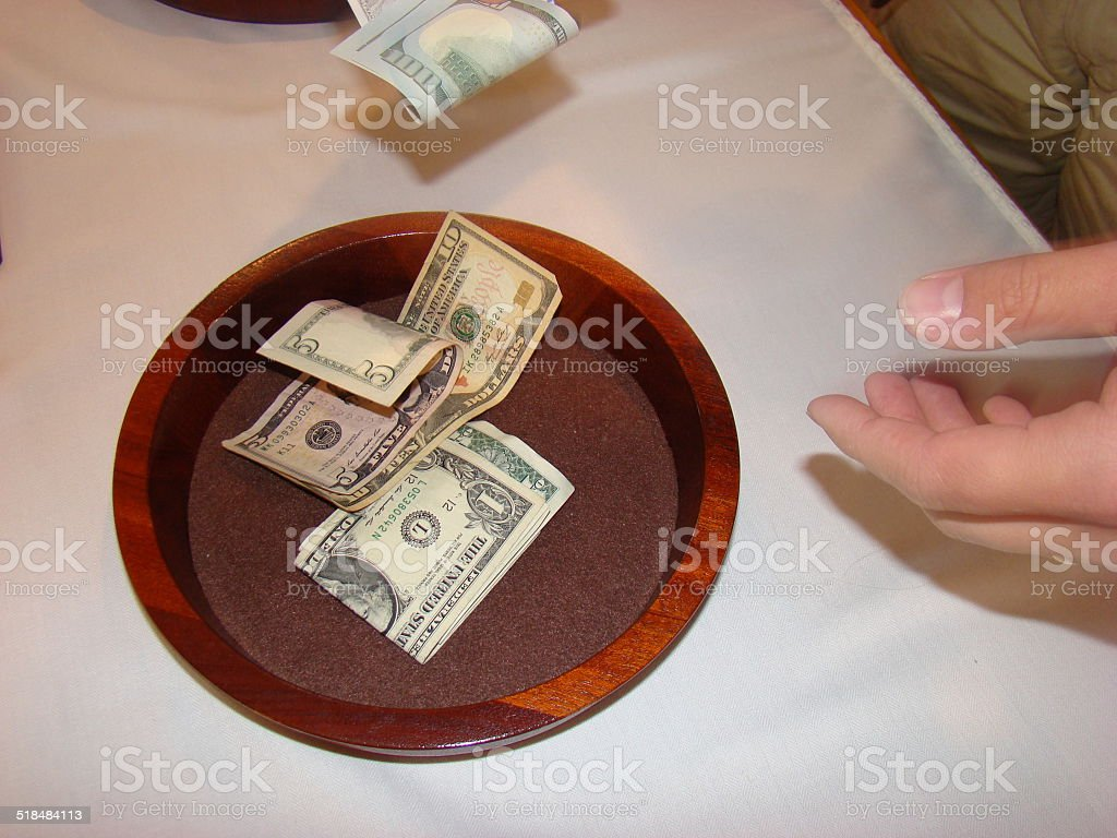 Man holding Religious Offering Collection Plate stock photo
