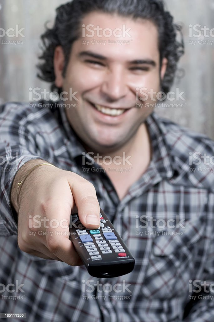 man holding remote control stock photo